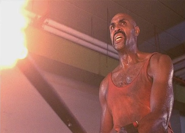It's a pimp-turned-bodybuilder with a flamethrower. What's not to like?